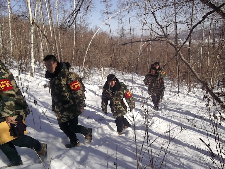 Forestry personnel conduct an anti-poaching patrol in the forest of Hunchun in March, 2012. Photo courtesy of Hunchun Forestry Bureau