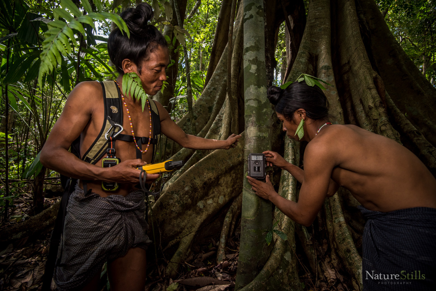 Former hunter-turned-parabiologists setting up camera traps in remote locations of Chittagong Hill Tracts. Photo Credit: Naturestills/Creative Conservation Alliance