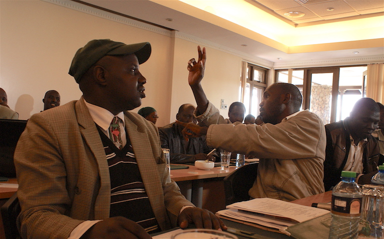 Joseph Towett (left), an Ogiek elder, during a National Land Commission meeting to deliberate on the Community Land Bill. The bill is scheduled to go into effect in a few weeks, and would enable local people to manage their forests with minimal interference from the government. Photo by David Njagi