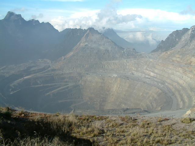 The giant Grasberg open-pit copper and gold mine in Indonesian Papua on the island of New Guinea. U.S.-based mining giant Freeport, which operates the mine, was also granted an exemption from the 1999 Forestry Law. Photo by Alfindra Primaldhi/Wikimedia Commons