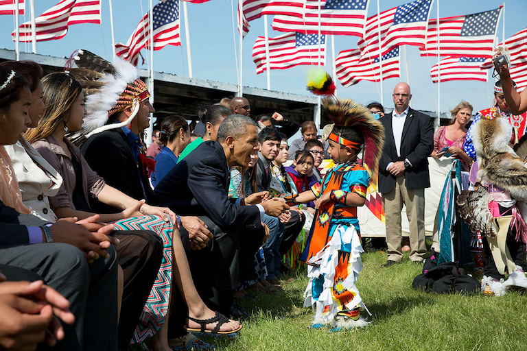 President Barack Obama greets a young boy during a visit to the Standing Rock Sioux Reservation in North Dakota on June 13, 2014. Photo by Pete Souza / The White House via Flickr