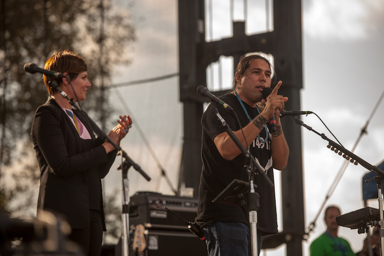 Dallas Goldtooth, a leader of the Dakota Access Pipeline protests and member of the Lower Brule Sioux tribe, speaks at a 2014 concert benefitting the Keystone XL pipeline opposition. Photo by J Grace Young / Bold Nebraska