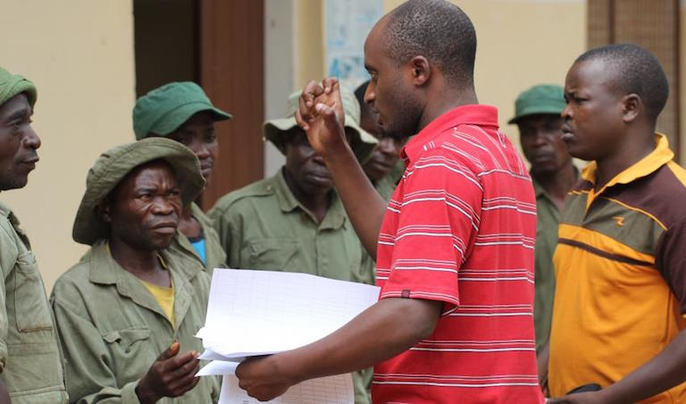 Max Jenes works with new ranger recruits. Photo courtesy of PAMS Foundation Tanzania