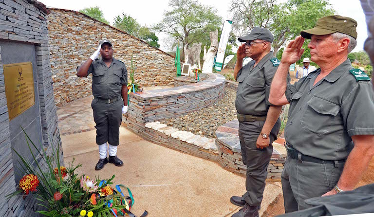 South Africa's director of anti-poaching efforts Johan Jooste and President Jacob Zuma lay a wreath at the Ranger Monument on Anti-Rhino Poaching Awareness Day in Kruger National Park in November, 2015. Photo courtesy of SanParks