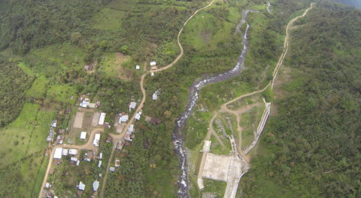 Aerial photo shows the town of San Pablo de Amalí, the Dulcepamba River, and the Hidrotambo dam facility. Photo by Santiago Pastór