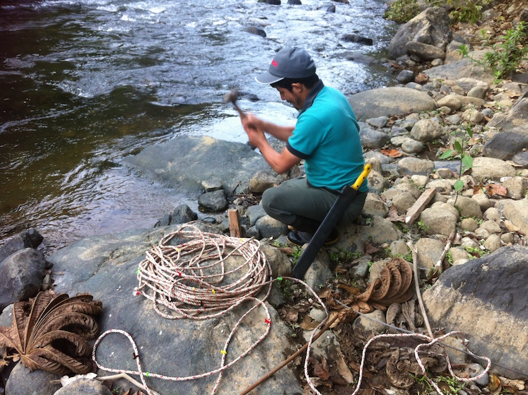 Manuel Trujillo sets up a transect to measure discharge on the Salunguirí River, a tributary of the Dulce Pamba River. Photo by Rachel Conrad