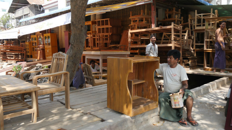 Wood workers at a shop in Mandalay, Myanmar. Many shops use illegally-sourced wood. Photo by David Doyle