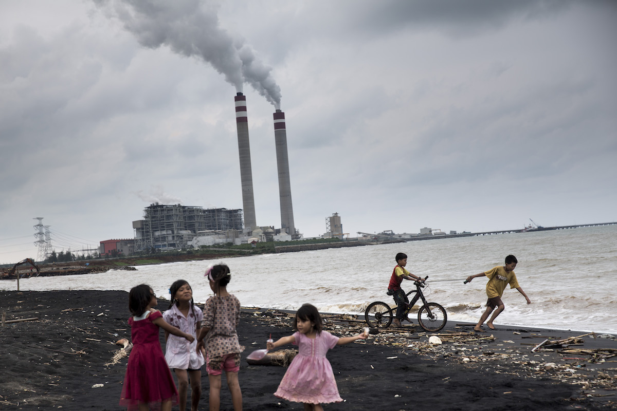 Children play by the beach near a coal power plant in Jepara, Central Java. Photo by Kemal Jufri/Greenpeace.