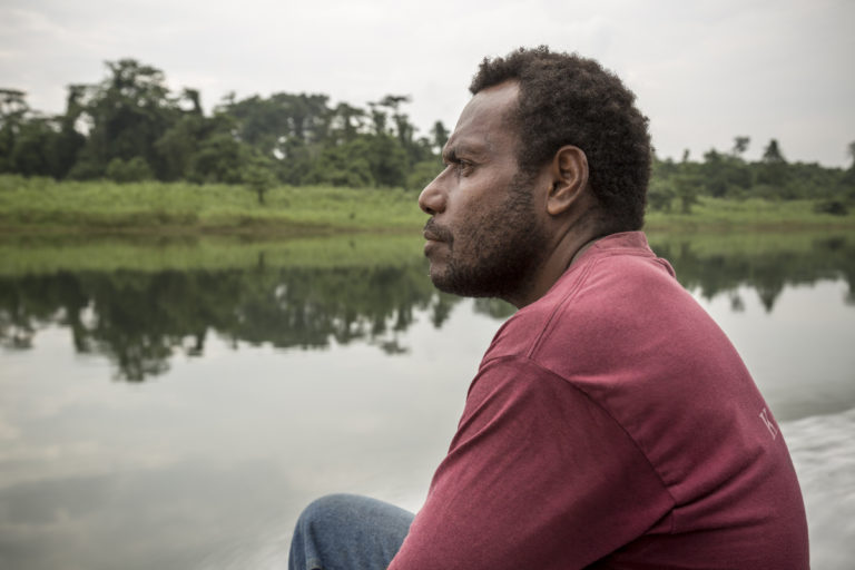 Paul Pavol (43) on a boat ride on the Wala River on the way to Tavolo on the island of New Britain, Papua New Guinea.  September 2, 2016. Photo by Fábio Erdos.