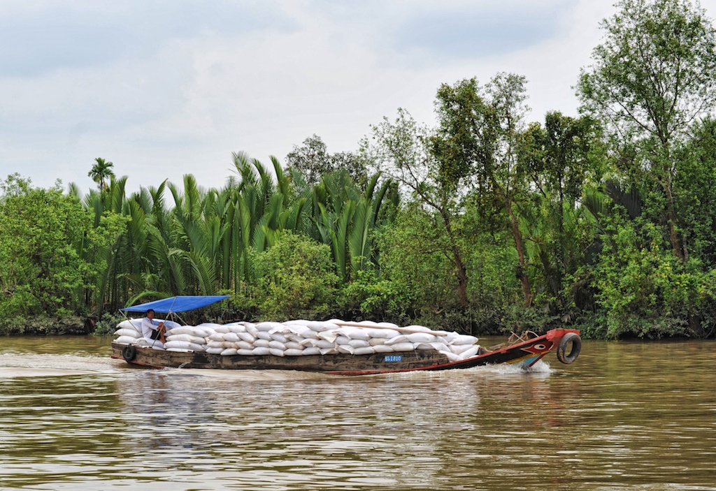 A boatload of rice in the Mekong Delta. Photo by Richard Vignola/Flickr