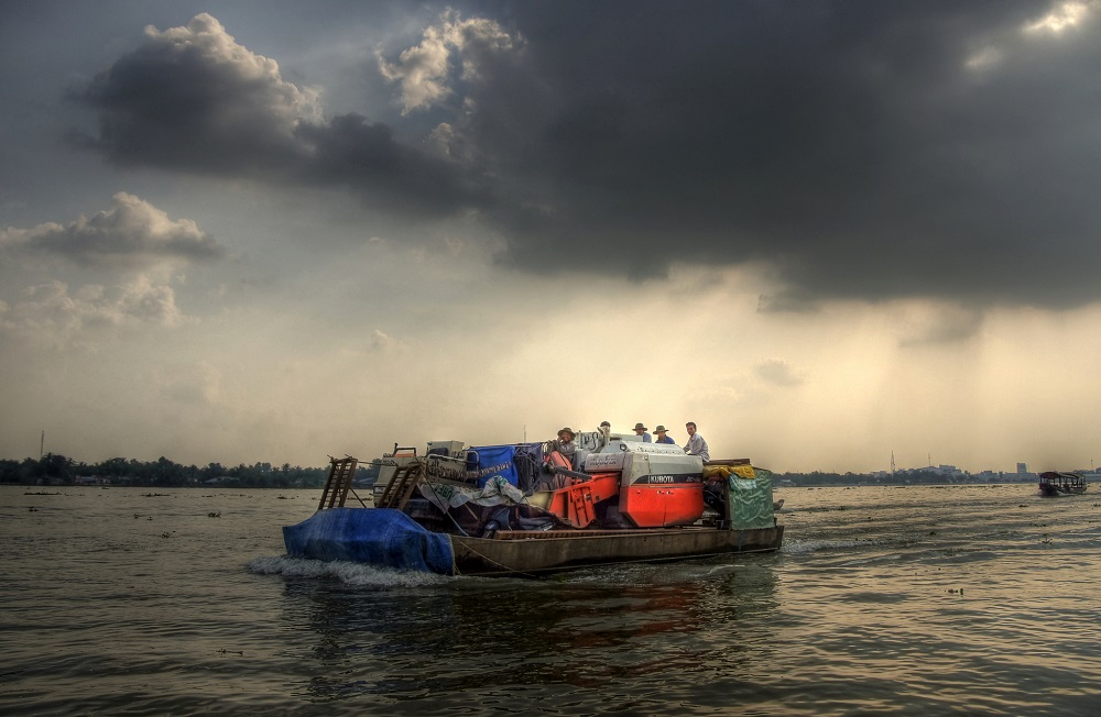 A fully loaded boat in Vietnam's Mekong Delta. Photo by mariusz kluzniak/Flickr