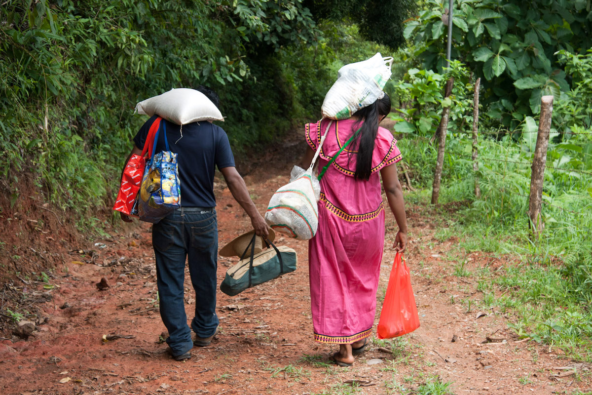 Residents of Kiad in Panama's indigenous Ngäbe-Buglé semi-autonomous region retur home after shopping in the nearby town of Tolé. Photo by Camilo Mejia Giraldo
