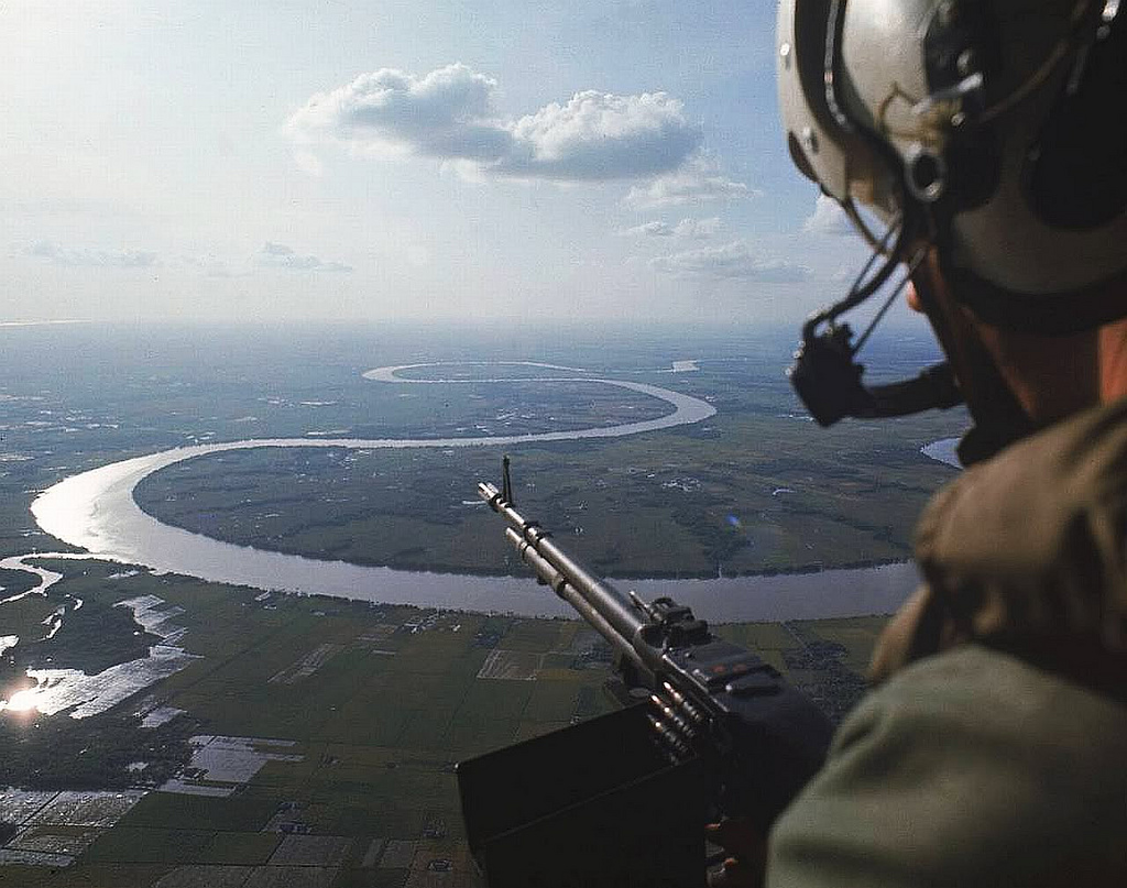 A heli door gunner over the Mekong Delta in 1967. Photo by manhhai/Flickr