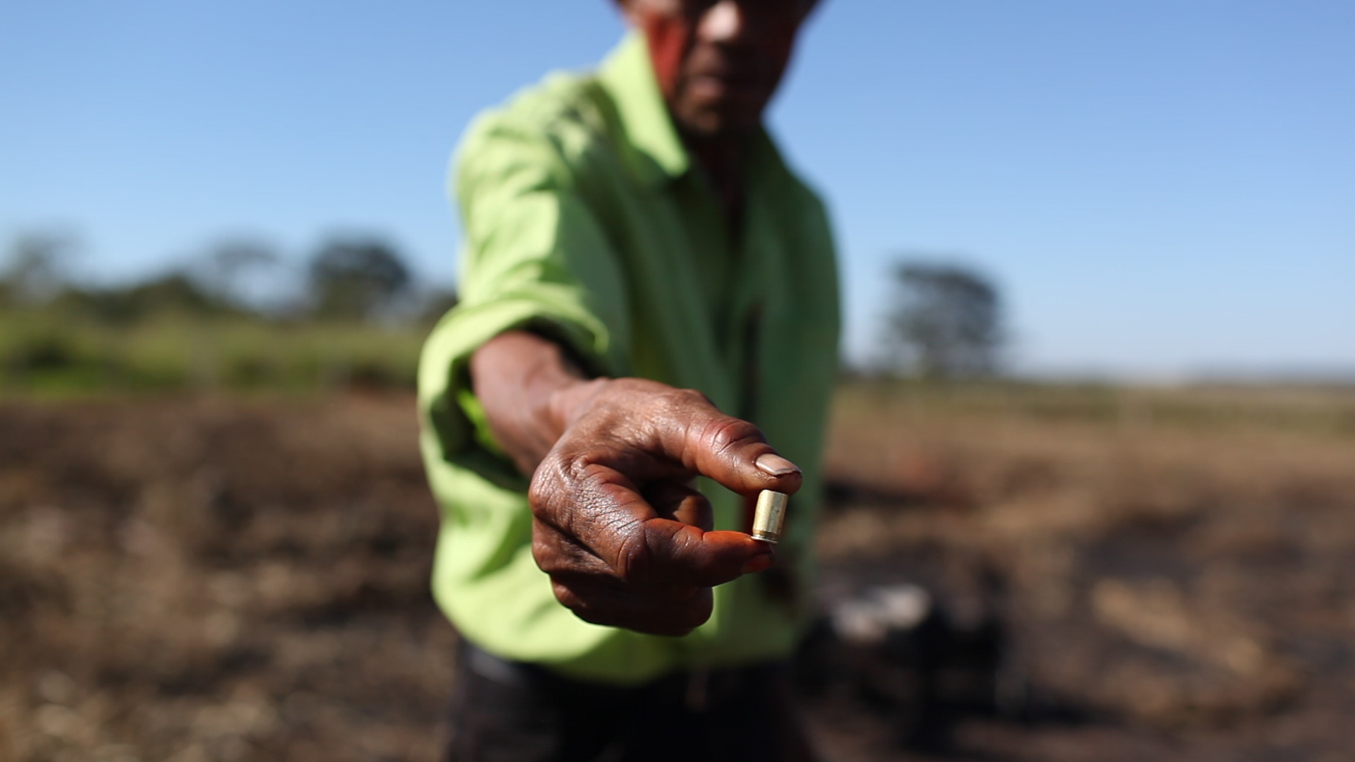 An indigenous man shows a bullet fired at the Yvu farm in a June 2016 conflict between Guarani Kaiowá Indians and Mato Grosso do Sul farmers. Photo courtesy of CIMI