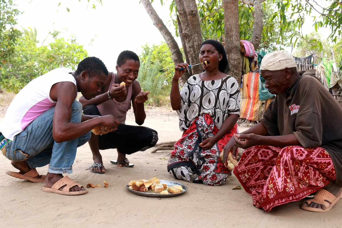 Mohammed Omar and his family -- members of the Sanye community -- feast on fresh honey. Photo by Sophie Mbugua