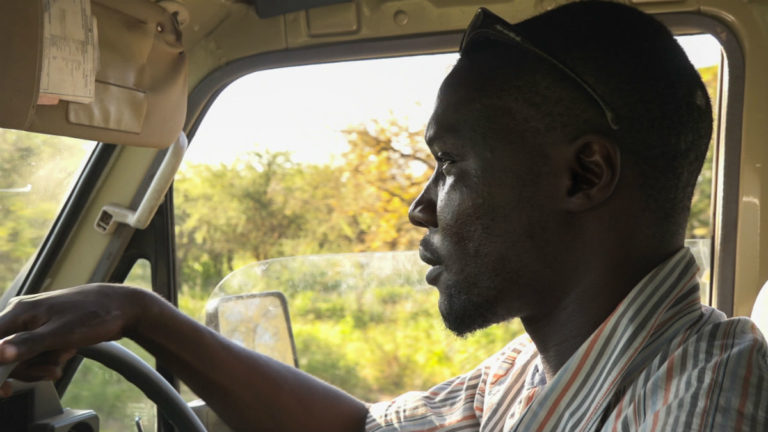 Tumaini Matinda drives his beat up 1995 Land Cruiser during one of his patrols in the forests of the Simanjiro district in northeast Tanzania. Photo by Willy Lowry