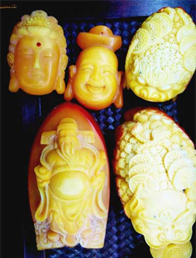 Carved pendants observed for sale in Luang Prabang, Laos. Photo ©Kanitha Krishnasamy/TRAFFIC