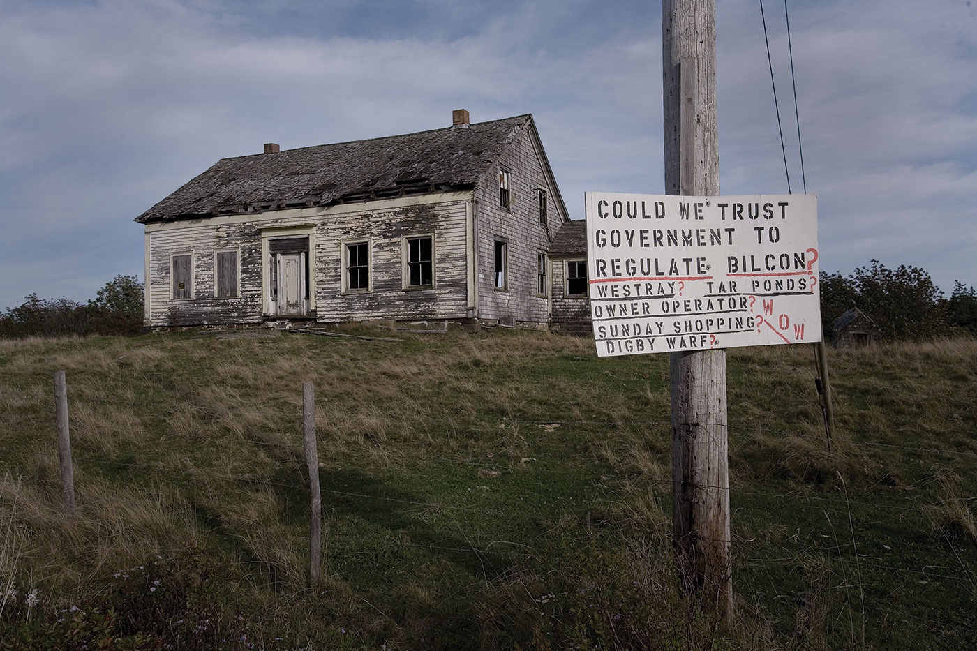 A protest sign sits in front of an abandoned home in rural Digby, Nova Scotia. During the five plus years that the environmental assessment was being conducted on the project, signs such as these, mostly against, but some in support of, Bilcon's plans, littered the otherwise quiet rural region. Today, some of these signs still stand, as the NAFTA Tribunal's award has yet to be finalized. Photo by Russel Monk licensed under the Creative Commons Attribution-Share Alike 2.0 generic license