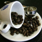 A coffee cup with beans. Photo by Lotus Head/Wikimedia Commons