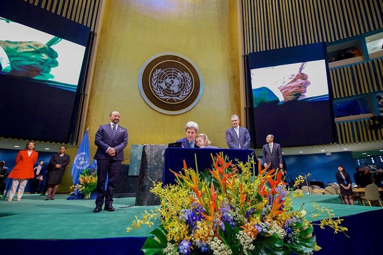U.S. Secretary of State John Kerry signs the Paris Climate Change Agreement at the UN on Earth Day, 2016. The US is bound by international law to abide by the agreement. Under its conditions, it would take President elect Trump four years to legally withdrawal, as he has threatened to do in the past. Photo courtesy of US State Department.