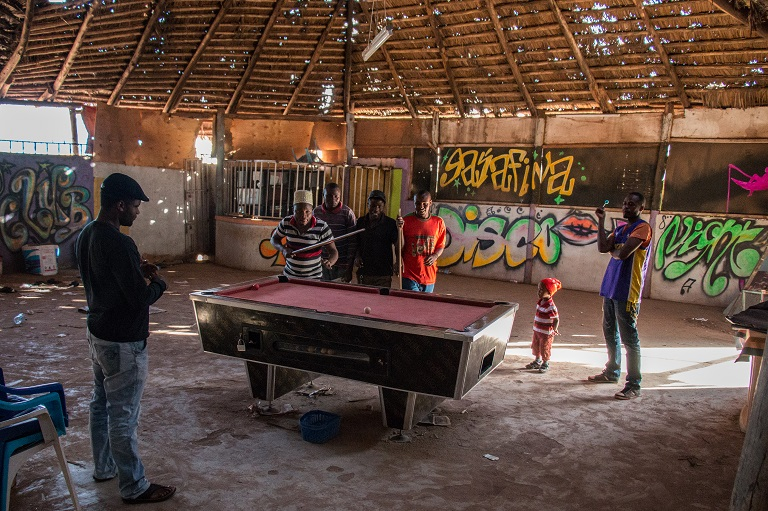 Tanzanians play pool at the Sacha Hotel on the Tanzanian side of Namanga. Locals cross to border constantly to shop, party or visit friends. Photo by Nathan Siegel