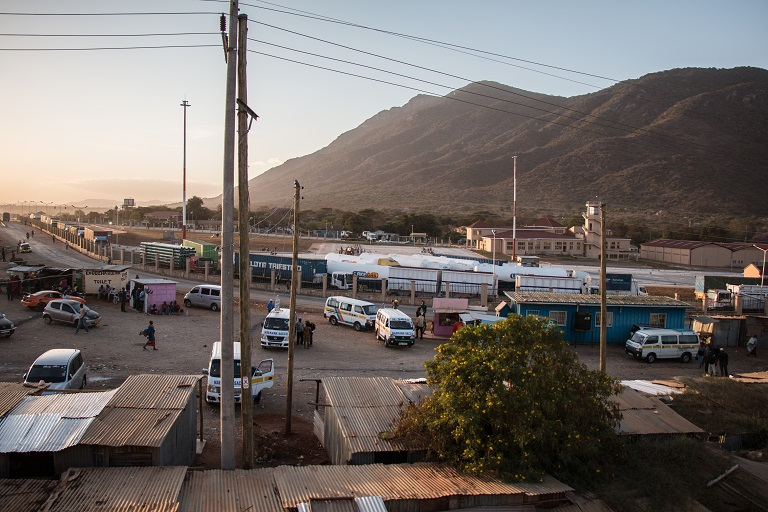 A bus stop in Namanga with the new border point under construction in the background. Photo by Nathan Siegel