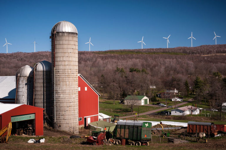 Strange irony: Wind turbines overlook a farm in the state of Pennsylvania, which voted Trump. US subsidized wind farms and solar installations would not just cut greenhouse gases, they would provide an economic boon to America's beleaguered farmers in GOP strongholds in Wyoming, Texas, Iowa, Indiana as well as other Great Plains and Midwestern states. Photo courtesy of USEPA