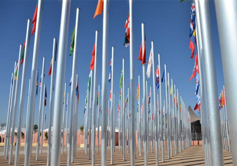 The flags of many nations fly at the COP22 climate conference meeting in Marrakesh. The nearly 200 nations committed to the Paris Climate Agreement were stunned this week when President elect Trump announced his plans to rush to withdraw from the accord. Photo by Justin Catanoso