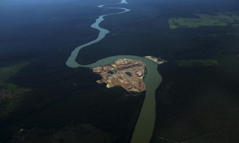 An aerial view of the construction site of a hydroelectric dam on the Teles Pires River – a tributary of the Tapajós River in the heart of the Amazon. Three dams have been completed on the Teles Pires so far, with the fourth, the The São Manoel dam, to be finished soon. Photo courtesy of International Rivers