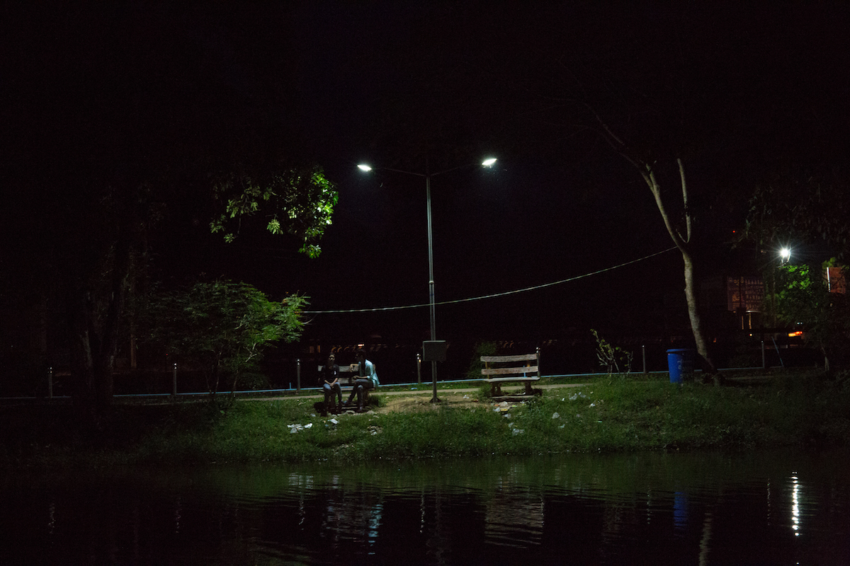A young couple sit beside Khan Thar Yar lake in Hpa An, Karen state's capital. Currently around 34 million people in Myanmar lack access to electricity, but almost all of the electricity generated by the Salween dams will be exported to China and Thailand. Photo by Demelza Stokes.
