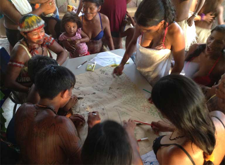 Indigenous Munduruku living on the Teles Pires River taking part in a mapping workshop. Indigenous people and river communities have seen, and will continue to see territory lost, fisheries disrupted and depleted, and food security diminished, with the construction of the Tapajós Complex. Photo by International Rivers on Flickr, licensed under an Attribution-NonCommercial-ShareAlike 2.0 Generic (CC BY-NC-SA 2.0) license