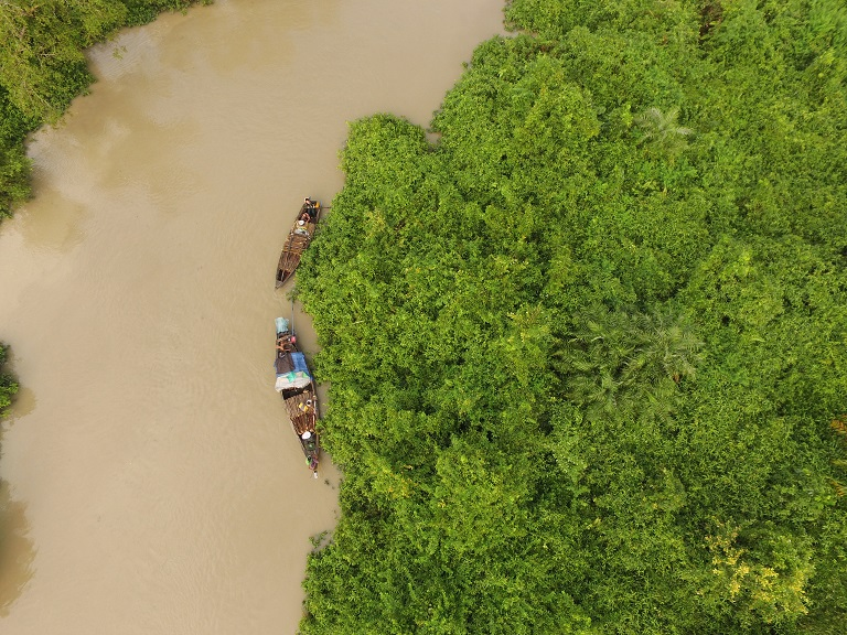 A drone image shows people in boats loaded with wood inside the MKWS mangrove sanctuary in October 2016. Photo courtesy of Fauna & Flora International