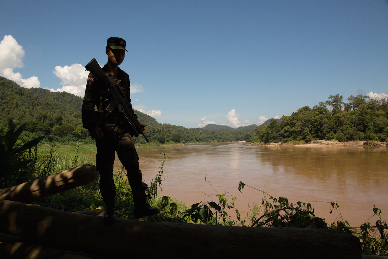 A soldier from the Karen National Liberation Army's Brigade 5 stands on the west bank of the Salween. The Karen National Union joined the Nationwide Cease-fire agreement on October 15 2015, but recent fighting between the Tatmadaw, the Border Guard Force and a DKBA splinter group has seen the KNU call on the Tatmadaw and BGF to cease military activities in Karen state, stating it could derail the peace process. Photo by Demelza Stokes.