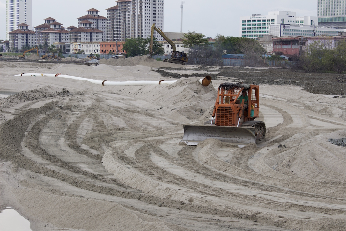 excavator-shifting-sand-between-pulau-melaka-and-the-mainland