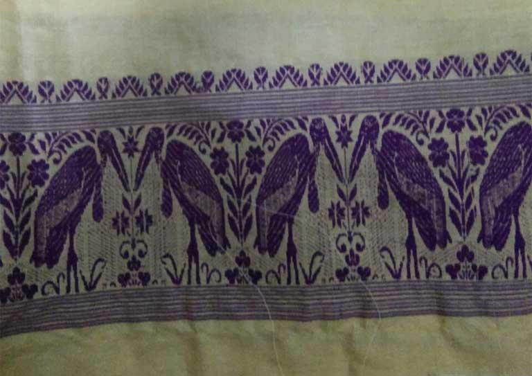 Traditional Assam silk textile with stork motif. Photo by Purinima Barman