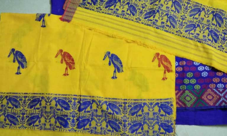 Silk with Greater Adjutant stork motifs. At present, village women have not been able to find a way to market these fine textiles, though it is hoped this could become possible in the future, benefiting both the villagers and the birds. Photo by Purnima Barman