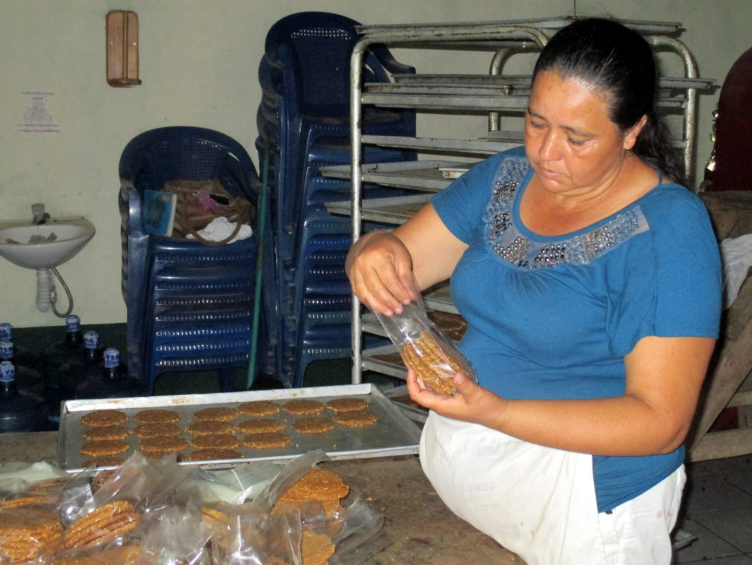 A local ANSA employee packages cookies made with ramón tree seed flour. The Guatemalan government has been promoting the cookies for snacks in public schools and within other state institutions. Photo by Sandra Cuffe