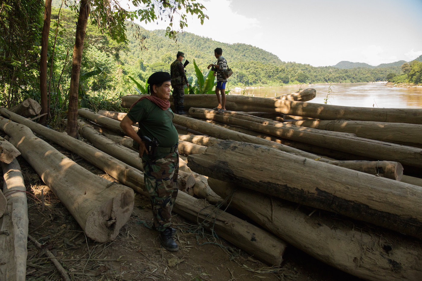 Lieutenant Colonel Kyaw Mue of the KNLA's 5th Brigade shows tons of illegally logged timber seized by his brigade earlier this year. He told Mongabay that the Karenni National People's Liberation Front had asked permission to transport the logs down the river through KNLA Brigade 5 territory, but were refused. Photo by Demelza Stokes.