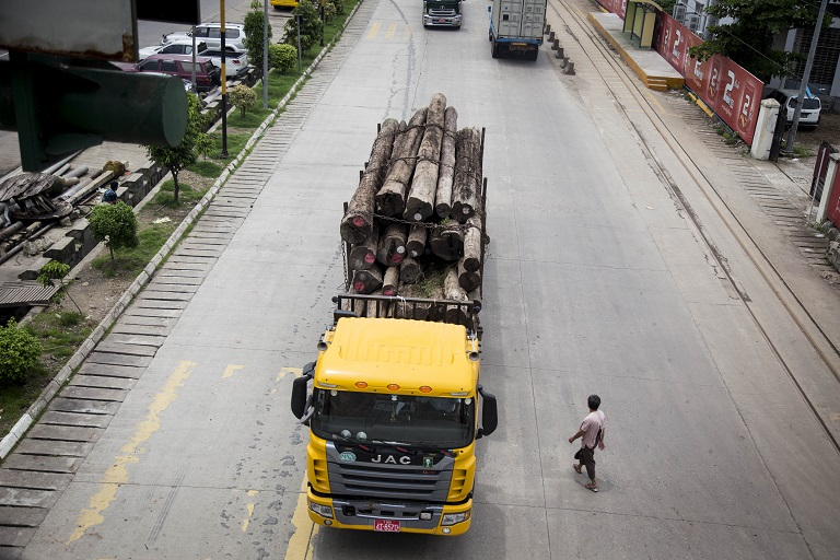A truck load of timber heads towards the ports at Yangon for export. Photo by Ann Wang for Mongabay