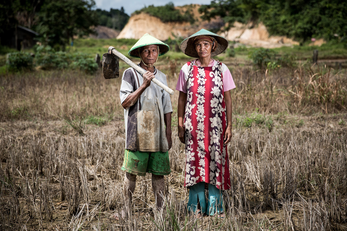 Komari, a 50 year-old farmer, and his wife Nurbaiti, at their damaged farm near a coal mine site in Makroman, East Kalimantan, Indonesian Borneo. Courtesy of Kemal Jufri/Greenpeace.