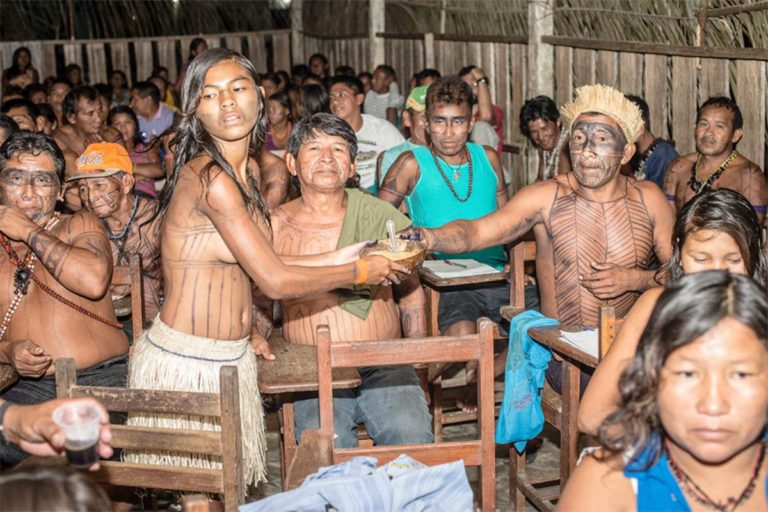 "Munduruku Indians meet to decide strategy regarding one of the four dams being built on the Teles Pires River, September 2014. Those dams would be vital to a future industrial waterway in the Amazon that would transport soy from Mato Grosso state downriver eventually to the Atlantic. The Indians have repeatedly won lawsuits against the dams. But the decisions have all been overruled by higher courts, using the ""suspension of security"" legal provision, a relic of Brazil's military dictatorship that can be used to overthrow virtually any lower court decision. Photo by Mauricio Torres"