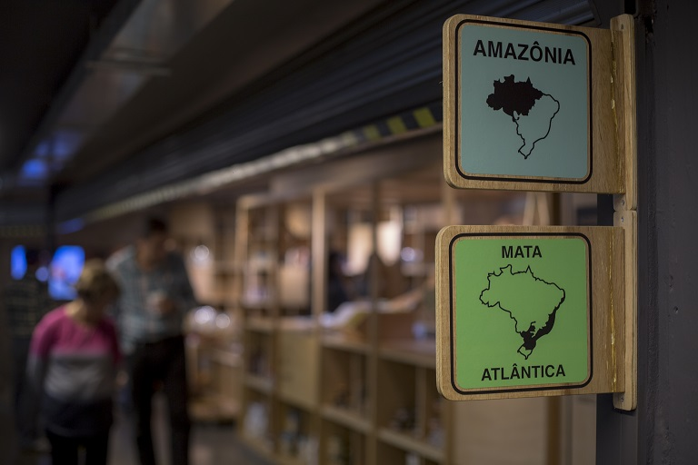 Signs indicate the origin of the food in the Municipal Market of Pinheiros where ingredients are sourced from different regions of the Brazilian Amazon. Photo by Mauro Pimentel for Mongabay