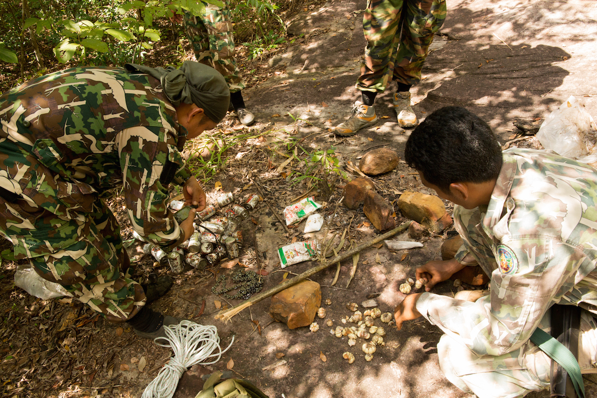 Salak Chairacha and his team of rangers in Thap Lan National Park log the location and make a record of the debris left behind by illegal Siamese rosewood loggers in November 2016. Photo by Demelza Stokes.