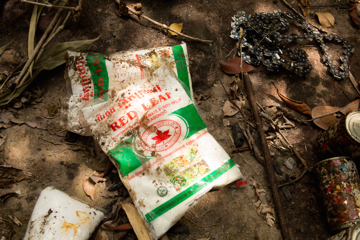 Cambodian language on packets of monosodium glutamate abandoned in Thap Lan forest highlights the international nature of the illegal trade in Siamese rosewood. Photo by Demelza Stokes.