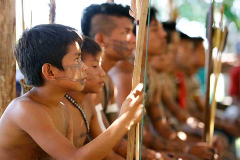 Munduruku warriors. A proud indigenous group today numbering 13,000, the Munduruku are making a defiant stand against the Brazilian government's plan to build dozens of dams on the Tapajós River and its tributaries. Photo by Mauricio Torres
