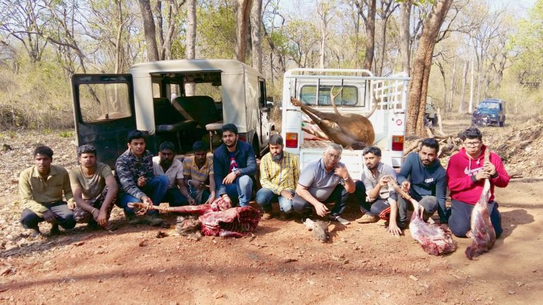 Poachers with seized Sambar carcass and vehicles from New Year's arrest. Photo credit: WCS-India