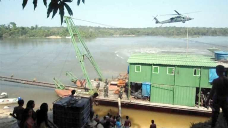 A police helicopter hovers during the Eldorado Operation above the gold mining barge before it was destroyed. This photo came from one of the only Munduruku cell phone cameras not destroyed by the Federal Police raiders. Photo courtesy of Movimento Ipereg Ayu