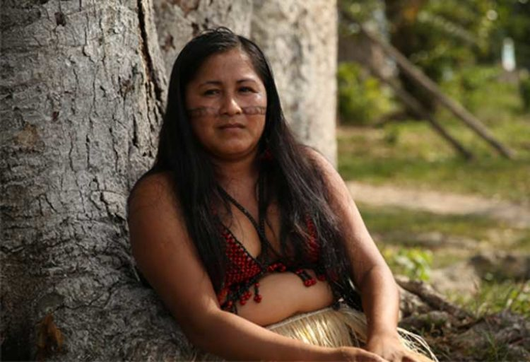 "Iandra Waro Munduruku: ""We were told to get ready for this visit, to prepare ourselves, just as you see us here, prepared for you [in ritual garb].… They told us we were going to have a meeting with them. So we came, but instead we received this terror. It was a day of terror."" Photo by Thais Borges"