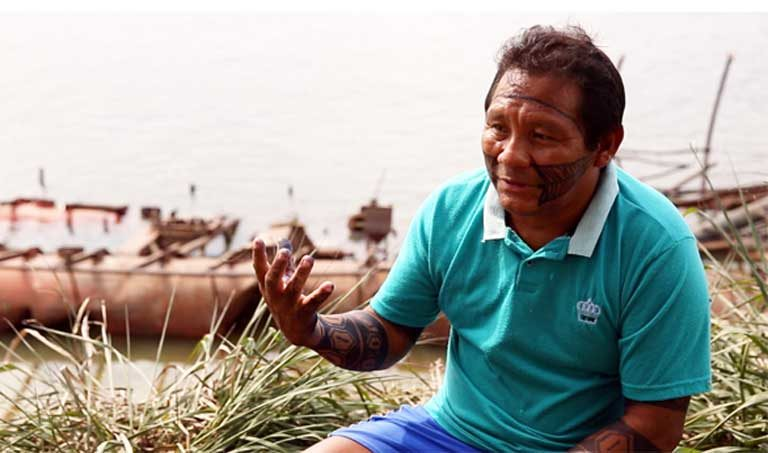 "Genivaldo Krixi Munduruku: ""I told [the police] to stop, to keep calm.… My brother was already in the water, bleeding. He was struggling to get out of the water. I was trying to help him. He was pulling himself out. Then the officer shot him in the head.… I've no doubt at all that [the police] wanted to kill him."" Photo by Thais Borges"