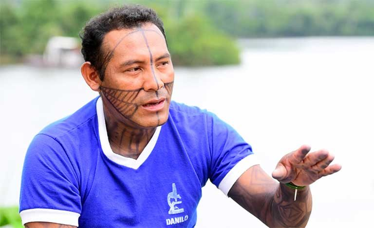"Danilo Krixi Munduruku: ""The police told us to leave our houses or they'd throw a bomb into them. The women came out, screaming with fear. They [the police] took us to the center of the village. Pointing machine guns at us, they made us lie on the ground and they handcuffed us. They said that, if a policeman was killed, we'd all be killed."" Photo by Mauricio Torres"
